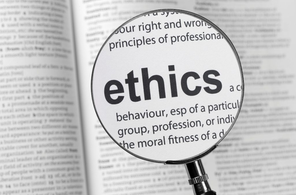 """magnifying glass focusing on word """"Ethics"""""""